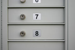 Mail boxes. Secure mail boxes with numbers stock photos