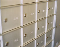 Mail Boxes. A grid of mail boxes in a new apartment complex stock photography