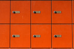 Mail boxes. Bucharest, Romania, 7 February 2016: Orange vertical mail boxes in a post office stock photos