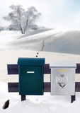 Mail boxes and footprints in snow Royalty Free Stock Images