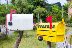 Mail boxes in front of suburb house. Royalty Free Stock Photos