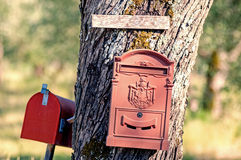 Mail boxes. Outdoor old fashioned mail boxes royalty free stock photography