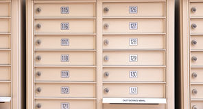Mail boxes. A set of mail boxes hanging on a wall stock photography