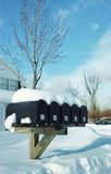 Mail boxes in the snow Royalty Free Stock Photo
