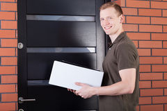 Mail carrier with a package Stock Photo
