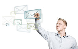 Young businessman selecting mail icon in the air. Royalty Free Stock Image