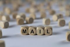 Mail - cube with letters, sign with wooden cubes. Mail - wooden cubes with the inscription `cube with letters, sign with wooden cubes`. This image belongs to the Royalty Free Stock Photo