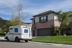 Mail Delivery. Mail truck makes a stop in a residential neighborhood Royalty Free Stock Images