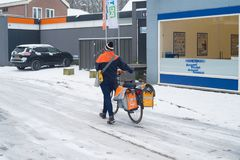 Mail delivery in snow stock photography