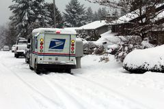 Mail delivery during snow storm. Despite heavy snow the Postal Service continues to deliver mail in western Washington Royalty Free Stock Photos