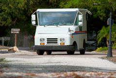 Mail delivery truck with mailboxes in background Royalty Free Stock Photos