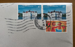 Mail envelope with cancelled stamps from German Royalty Free Stock Photos