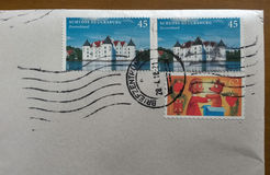 Mail envelope with cancelled stamps from German Stock Photos