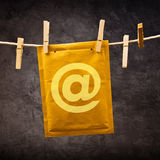 Mail Envelope with monkey sign on clothes rope Royalty Free Stock Photography