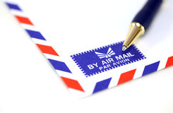 Mail envelope with pen Royalty Free Stock Photo