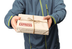 Mail express delivery. Male courier service worker holding express delivery package royalty free stock photo