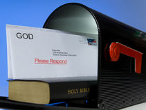 Mail from God. Mail box containing Holy Bible on white background, symbolizing that the Bible is a message or mail from God Royalty Free Stock Photos