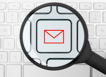 Mail icon under the magnifying glass Royalty Free Stock Images