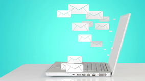 Mail icons coming out of laptop stock footage