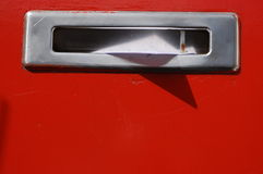 Mail letter delivery. Mailbox in the sun on a red door Stock Image