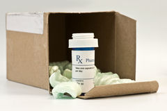 Mail Order Meds. Mail order prescription with box and styrofoam peanuts Royalty Free Stock Image