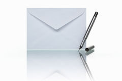 Mail and pen. PHOTOGRAPH (NOT illustration or 3D render) of envelope mail and pen, shot against white background Stock Photo