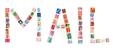 Mail in postage stamps. A concept photograph of many world postage stamp forming the word Mail Royalty Free Stock Photography
