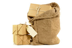 Mail sack full with pile of plain wrapped parcels, isolated on white background Royalty Free Stock Image