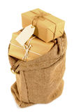 Mail sack or post bag with several wrapped packages or parcels inside, isolated on white background Stock Image