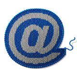 Mail sign of knitted fabric isolated on white background Stock Photography