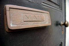 Mail Slot. Let's see if the mail came Royalty Free Stock Images
