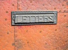Mail slot. In metal covered door, random nailing Royalty Free Stock Image