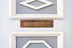 Mail slot in wood door Stock Image