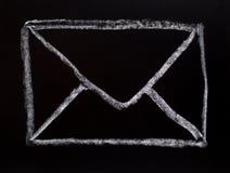 Mail symbol drawn on blackboard Stock Images