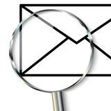 Mail symbol. Magnifying glass focusing on mail Stock Image