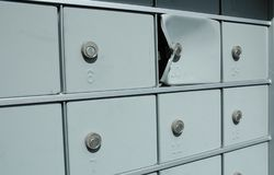 Mail Theft. Damaged mailbox broken into by thieves Stock Images