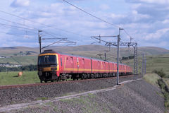Mail train descending Shap on West Coast Main Line. View of a mail train descending Shap near Greenholme just North West of Tebay in Cumbria. The train is made Royalty Free Stock Photo