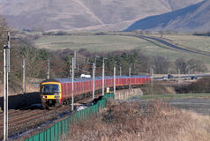 Mail train on the West Coast Main Line at Beckfoot Royalty Free Stock Image