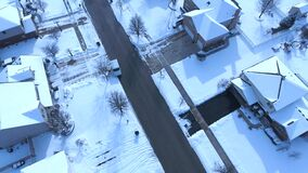 Aerial view of United States Postal Service delivering mail on a cold snowy winter day. Mail truck with mail carrier delivering packages to postal street box stock footage