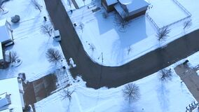 Aerial view of United States Postal Service delivering mail on a cold snowy winter day. Mail truck with mail carrier delivering packages to postal street box stock video