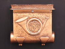Mailbox. In copper, decorated with a posthorn (symbol of the postal services Royalty Free Stock Images