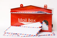 Mailbox. White envelope in red mail box Royalty Free Stock Image