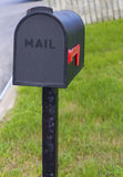 Mailbox. New black mailbox with the flag down Royalty Free Stock Image