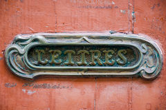 Mailbox. Close up of old French letterbox in old door Royalty Free Stock Photo