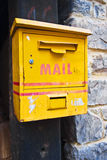 Mailbox. Grunge yellow mailbox old and empty in a portal Royalty Free Stock Image