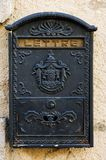 Mailbox. Black metal mailbox on the yellow stone wall Royalty Free Stock Photo