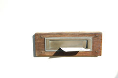 Mailbox. A wooden framed mailbox with letter on a white wall in sunshine Royalty Free Stock Images