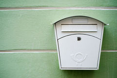 Mailbox. White mailbox on a green wall Royalty Free Stock Photos
