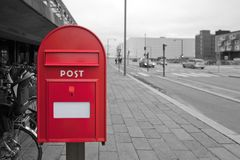 Mailbox on the background of a black and white street without inscriptions Royalty Free Stock Image