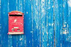 Mailbox in a blue door Royalty Free Stock Photography